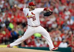 Starting pitcher Lance Lynn throws during the first inning against the Pittsburg Pirates in St. Louis. 7-09-14