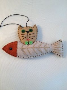 Cat and Fish Fabric Ornament - Hand Made Tony http://www.amazon.com/dp/B00KHV2C44/ref=cm_sw_r_pi_dp_F4nJub19SHR22