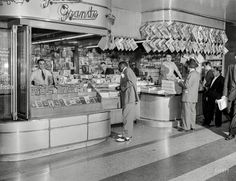 "New York, 1946. ""Garcia Grande newsstand."" With the freshest issues..."