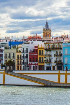 Seville's identity is congenitally linked to Triana, a soulful neighbourhood on the west bank of the Guadalquivir River whose past is littered with stories of sailors, ceramicists, matadors, flamenco singers and dancers, Roma rebels and own festivals. Seville, Spain