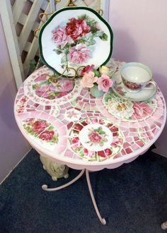 Awesome shabby-chic mosaic garden table.