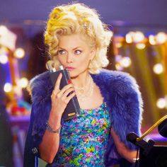 Promotional still of Velma Von Tussle, portrayed by Michelle Pfeiffer, on the set of Hairspray (2007)
