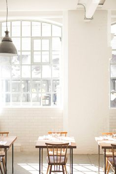 Lyle's is a new restaurant in East London founded by chef James Lowe. Specialising in modern British cuisine, it's minimal interior features polished concrete, reclaimed wood and painted brickwork.