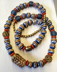 Check out this item in my Etsy shop https://www.etsy.com/listing/528904327/boho-sea-style-krobo-bead-necklace-and