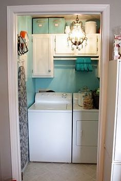 Small laundry room...put a shelf over the top of the machines