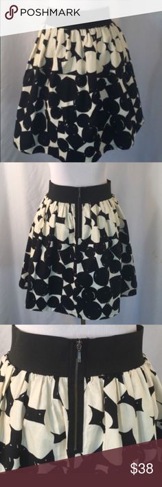 "We ❤️ Vera Skirt from Anthropologie Adorable We ❤️ Vera black and white polka dot circle skirt from Anthropologie.  The fully lined skirt has an exposed back zipper and 2"" wide black elastic contrasting waist band. 100% Cotton. Machine washable. Size 4. Waist 28"". Length 19"". Like new condition. No flaws or signs of wear. Anthropologie Skirts A-Line or Full"