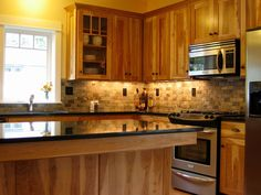 Craftsman Kitchen with full backsplash, Stone Tile, Kitchen island, High ceiling, Casement, Simple granite counters, L-shaped