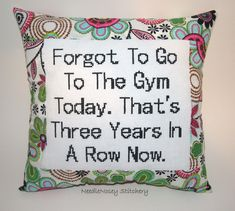Funny Cross Stitch Pillow, Pink and Green Floral Pillow, Exercise Quote. $23.00, via Etsy.