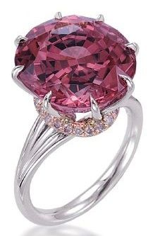 "8 ""claw"" prong ring set with a Pink Tourmaline and light pink diamonds, by Tamir."