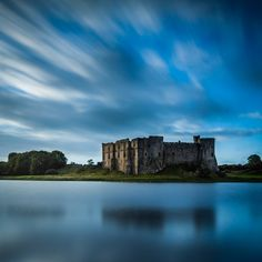 "Carew Castle. 3m E of Pembroke, Pembrokeshire, South Wales, is described by many as the ""most handsome in all South Wales,"" and is also the site of the ancient Carew Cross.  The 11th century cross is inlaid with fine Celtic knot-work and interlaced ribbon pattern."