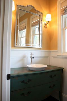 """Powder Room:  another example of re-purposing a dresser as a vanity w/a vessel sink (very similar to my powder room -- used antique night stand, painted it w/Maine Cottage """"Sprout"""" + cut a hole + dropped in a very modern, sculptural vessel sink )"""