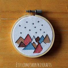 For sale on my Etsy Shop. Mountain and stars outdoor scene cross stitch