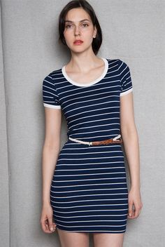 This navy striped mini dress rocks a sweet nautical style that has you walking in sunshine Includes a rope and braided faux leather belt to complete the beach-ready look.