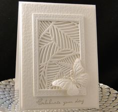 handmade birthday card designed and created by Peggy Dollar ... all white ... die cuts and embossing folder texture ... butterfly, frame and mod leafy look grill ... luv the finished look ...