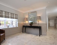 Dado walls in entry. Paneling painted in Elephants Breath with Skimming Stone above, paint available from Farrow & Ball. Painted Wood Walls, Wood Panel Walls, Wall Wood, Paneling Painted, Flur Design, Hall Design, Design Hall Entrada, Wood Paneling Makeover, Contemporary Hallway