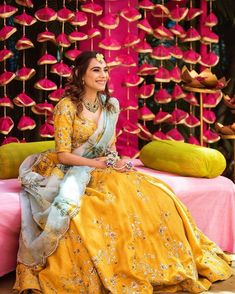 Bride in a yellow lehenga with floral embroidery with contrasting printed dupatta on her mehndi function Bridal Mehndi Dresses, Mehendi Outfits, Muslim Wedding Dresses, Wedding Dresses For Girls, Indian Wedding Outfits, Bridal Outfits, Bridal Lehenga, Girls Dresses, Indian Outfits