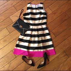 "⭐️HP SALE⭐️ Eliza J Stripe Crepe Fit & Flare Dress ✨This item will be marked down 10% to celebrate its host pick!!✨ Two-tone stripes gloss this satiny party dress shaped by crisp pleats and punctuated by a final, color-popping pink chiffon panel encircling the hem. Perfect condition, worn once!  37 1/2"" length. Back keyhole with button-and-loop closure. Hidden side-zip closure. Side-seam pockets. Fully lined.  Sorry No Trades or Offline Transactions  Offers Welcomed ✅ Bundle Discounts  Next…"