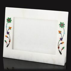 White Marble Ornament Novelty Photo Frame 5 X 7 with Stand ShalinIndia,http://www.amazon.com/dp/B00EXHSV02/ref=cm_sw_r_pi_dp_mhPktb0Y22CH6S39