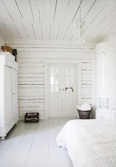 so lovely all white, painted floorboards, white woodwork, white ceiling and white linen, plus lovely fireplace