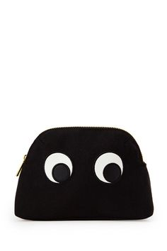 A woven canvas cosmetic bag with embroidered faux leather googly eyes on  both sides and a a372a9f5ae