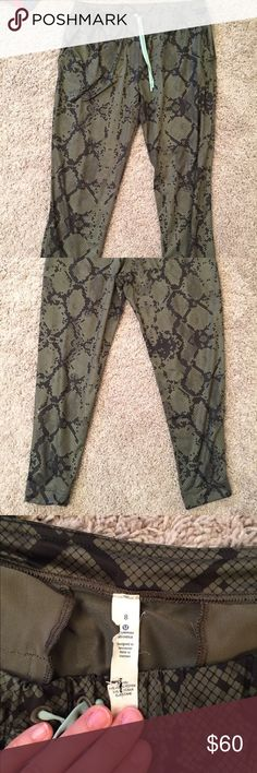 Lululemon camo pant Camo ankle pant by Lululemon. Army green with black; teal drawstring. Back slit pockets. Size 8. lululemon athletica Pants Ankle & Cropped