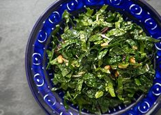 KALE SALAD:    4 cups baby Kale    1/4 cup pine nuts, toasted (microwave, 30s at a time)      Dressing:  2 T fresh-squeezed lemon juice    1/4 cup olive oil    1/4 cup drained sun-dried tomatoes, minced  1 large clove garlic, minced or pressed    salt and pepper      Method:  Wash Kale and slice into bite-sized pieces.  Whisk dressing ingredients together.  Add dressing to Kale, mix and refrigerate  Add pine nuts just before serving