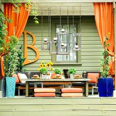 Deck Landscaping Ideas BHG.com  Love the curtains attached to the pergola with geometric candleholders suspended