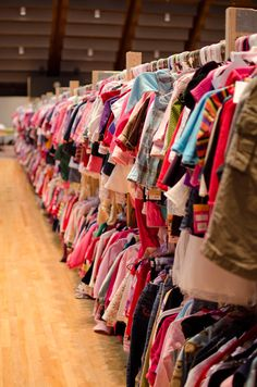 Rows of children's clothing waiting to be shopped - www.jbfsale.com