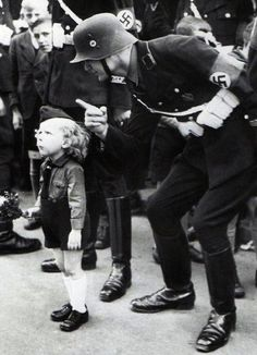 Disciplining a Hitler Youth. Brainwashed since birth. I pity those little ones.