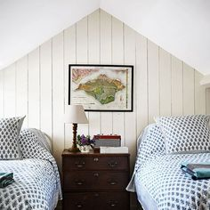 Small attic bedroom with wood panelling