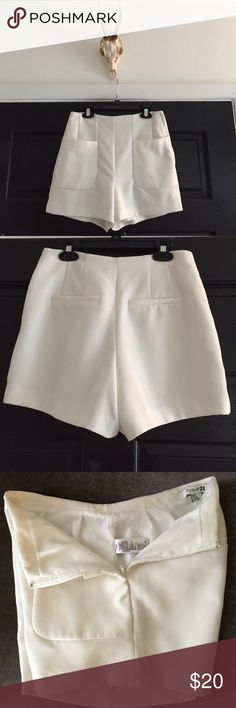 High Waisted Dress Shorts Off White High Waisted Dress Shorts. Two pockets on the front side, zips up the left side and built in satin-like slip on the inside. Size Small. Shorts