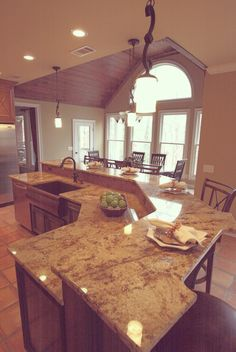 This is an absolute must in the new house- a shaped island to maximize space and function!