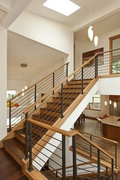 Contemporary Staircase With Hardwood Floors, Skylight, High Ceiling,  Pendant Light, Metal Staircase