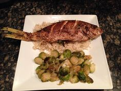 Fried red snapper over basmati rice and sautéed Brussels sprouts