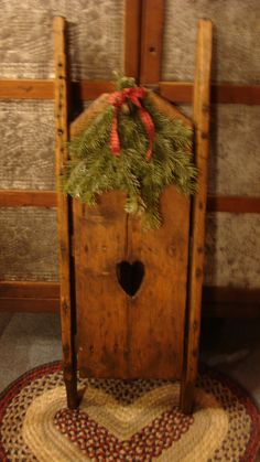 Antique sled with swag. Repinned by www.mygrowingtraditions.com