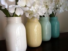 Painted mason jar vases - -pour paint into clean mason jar, rotate until inside is completely covered, pour out excess and let dry