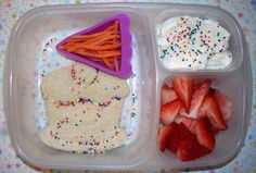 A peanut butter and jelly sandwich, strawberries, carrot matchsticks and honey Greek yogurt.  We added lots of sprinkles for fun, all in our #Easy #Lunchbox.