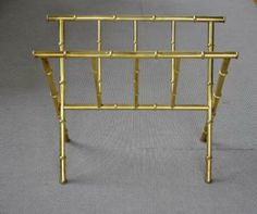 Antique gold bamboo magazine rack (£295 eek). Love the style, like old bar carts.