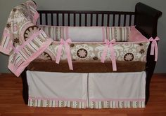 Bristol Baby Bedding  This custom 3 piece baby crib bedding set includes the plush boutique bumper pad, kick pleat detailed crib skirt, and so soft minky edged and backed blanket.  The designer coordinating twill fabrics, pink grosgrain ribbon, white and pink pique piping and trim and ultra soft pink and white minky combine softness and texture. The best for your little angel's nursery.