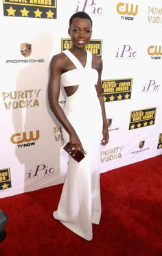 Lupita N'Yongo, in Calvin Klein, attends the19th Annual Critics' Choice Movie Awards at Barker Hangar on January 16, 2014 in Santa Monica, California.