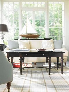 Black Coffee Table Striped Blue And Brown Rug White Sofa Chair With Caster Legs Silk Pillows