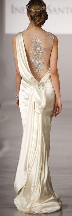 Fabulous gown - how much classier to reveal the back than the front........!