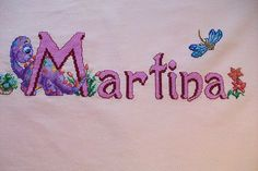 Cuadro con el nombre de Martina en punto de cruz