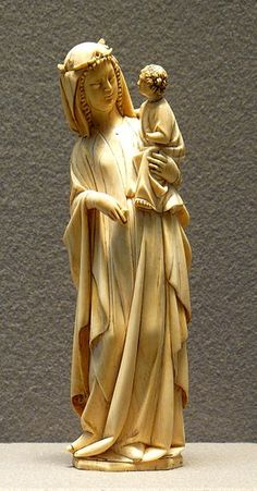 French ivory Virgin and Child, end of 13th century, 25 cm high, curving to fit the shape of the ivory tusk