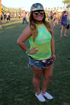 Pin for Later: All the Coachella Style You Have to See From Last Year's Festival  Flashes of neon and a metallic fanny pack were played up by a pastel purple lip.