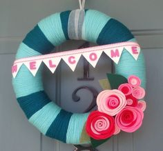 Made a 'Welcome Baby' Wreath with green and yellow fabric and ribbons I used for the nursery :-)