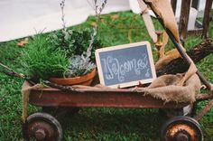 rustic wagon and welcome sign- perfect decoration for a country themed wedding