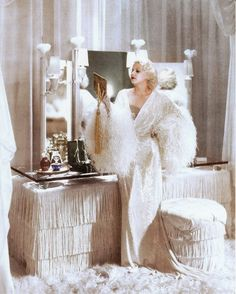 Jean Harlow in front of fabulous fringed vanity table #JeanHarlow #vintageboudoirs