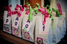 Favor bags for Apple ABC School themed birthday party!  In addition to the child's name, the first letter of their name was printed in both upper and lowercase.  Cute idea!   www.thatpartychick.net