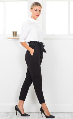 These black cigarette pants feature a tie waisted belt and a high waisted finish, perfect for a day at work followed by an evening out